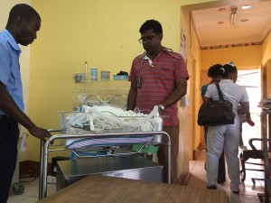 Dr Ravi working on patient transfer to Bustamante Children's Hospital